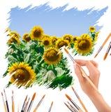 Рука с panit чистит красить щеткой солнцецветы Стоковое Изображение