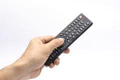 Рука с remote стоковое изображение