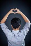 Рука формы влюбленности красивый человеком Стоковая Фотография