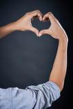 Рука формы влюбленности красивый человеком Стоковые Фотографии RF