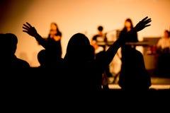 Рука хваления вверх в церков стоковое фото rf