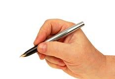 Рука человека с ручкой Стоковое Фото
