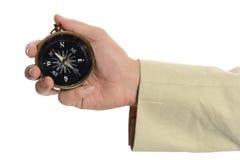 Рука человека держа компас Стоковая Фотография RF
