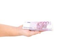 Рука человека держа 500 счетов евро Стоковое Фото