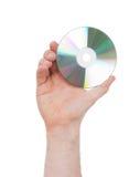 Рука человека при изолированный компакт-диск Стоковые Изображения