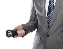 рука электрофонаря используя Стоковая Фотография RF