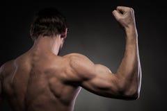 Рука людей силы на черноте Стоковое Изображение RF