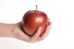 рука яблока стоковое изображение