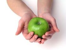 рука яблока Стоковые Изображения