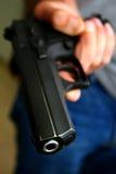 рука 3 держит пистолет Стоковая Фотография RF