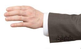 Рука Businessmans держа пустой космос на белизне Стоковые Изображения