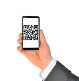 Рука Businessmans показывая smartphone Стоковая Фотография RF