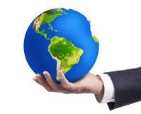Рука ` s бизнесмена держа планету земли Стоковое фото RF
