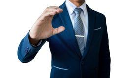 Рука ` s бизнесмена держа что-то на белой предпосылке Стоковые Фото