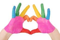 Рука ` s ребенка покрасила акварель в сердце Стоковая Фотография