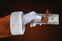 Рука Santa Claus с деньгами Стоковые Изображения RF