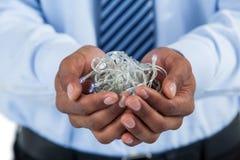Руки бизнесмена приданные форму чашки с fairy светами Стоковое Изображение