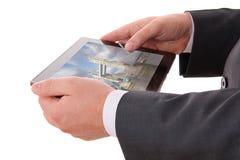 Руки бизнесмена с таблеткой Стоковое фото RF