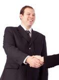руки бизнесмена трястия детенышей Стоковые Фотографии RF