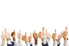 Руки бизнесменов держа большие пальцы руки вверх Стоковые Изображения
