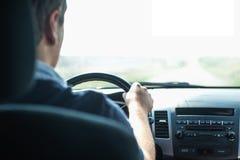 Руки водителя на колесе Стоковая Фотография