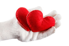 Руки в белых перчатках держа сердца Стоковое Изображение
