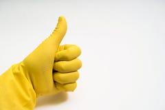 Руки в желтых резиновых перчатках на белой предпосылке Стоковое Изображение