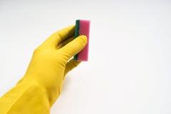 Руки в желтых резиновых перчатках на белой предпосылке Стоковые Изображения