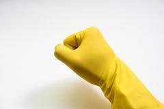 Руки в желтых резиновых перчатках на белой предпосылке Стоковая Фотография RF