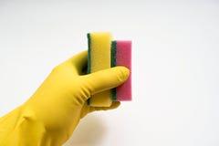 Руки в желтых резиновых перчатках на белой предпосылке Стоковое фото RF