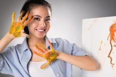 Руки в красках стоковые фотографии rf