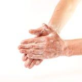 Руки в пене Стоковые Изображения