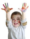 Руки в пестротканых красках Стоковое фото RF