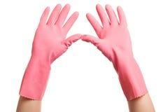 Руки в розовые отечественные перчатки раскрывают Стоковые Фотографии RF