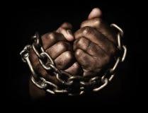 Руки в цепях стоковое изображение rf