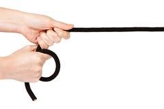руки держа веревочку Стоковое Изображение RF