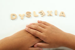 Руки девушки формируют дислексию слова Стоковая Фотография RF