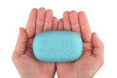 Руки держа голубой бар мыла с мытьем ваши руки написанный Стоковая Фотография RF
