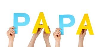 Руки держа папу Стоковые Изображения