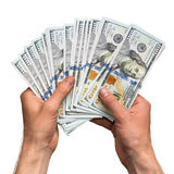 Руки держа пригорошню денег Стоковые Изображения