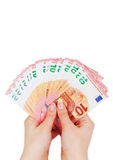 2 руки держа 10 примечаний евро изолированный на белизне Стоковое фото RF