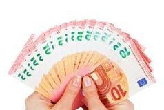 2 руки держа 10 примечаний евро изолированный на белизне Стоковые Изображения RF