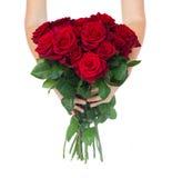 Руки держа розы стоковое фото rf