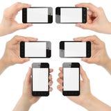 Руки держа умные телефоны Стоковые Изображения RF