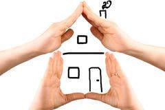 Руки делая форму дома Стоковая Фотография