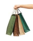 Руки женщины держа хозяйственные сумки Стоковое Изображение RF