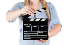 Руки женщины держа clapboard Изолировано на белизне Стоковые Изображения RF