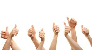 Руки и большие пальцы руки вверх изолированные перед белой предпосылкой стоковая фотография
