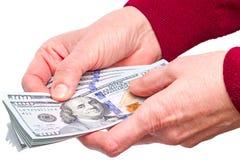 Руки и новые 100 долларовых банкнот Стоковое Изображение