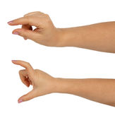 Руки кавказской женщины для того чтобы держать некоторые малые и большие объекты Стоковое Изображение